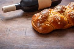Challah bread with a bottle of red wine on wooden table, copy space. Shabbat concept, challah bread with a bottle of red wine on wooden table, copy space royalty free stock photos