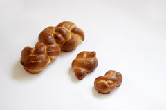 Challah bread small and big. Three shabat challah. Bread used by Jews in a Shabat ceremony royalty free stock image