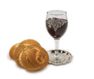 Challah with glass of wine on white Stock Image