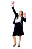 Challange accepted. Successful competitive businesswoman is happy and and has boxing gloves while wearing a suit and isolated on white background stock photos