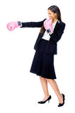 Challange accepted. Successful competitive businesswoman is happy and and has boxing gloves while wearing a suit and isolated on white background stock images