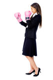 Challange accepted. Successful competitive businesswoman is happy and and has boxing gloves while wearing a suit and isolated on white background royalty free stock photography