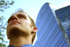 The challenge. Young business man rises to the challenge royalty free stock images