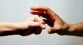 Challenge, competition. Two hands one puching and the other one catching the punch royalty free stock image