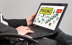 Challenge concept on a laptop. Businessman watching challenge concept on a laptop Royalty Free Stock Images