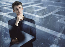 Challenge concept multiexposure. Thoughtful young businessman on abstract city background with maze, labyrinth. Challenge concept. Double exposure Royalty Free Stock Images