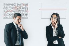 Challenge and idea concept. Businessman and woman with maze sketch on white background. Challenge and idea concept stock images