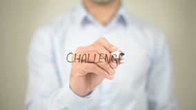 Challenge,  Man writing on transparent screen Royalty Free Stock Photo