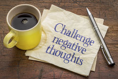 Challenge negative thoughts. Inspirational advice or reminder - handwriting on a napkin with a cup of coffee stock photos