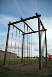 Challenge Ropes 1. A rack of climbing ropes stands ready to challenge military recruits at a training base Stock Image