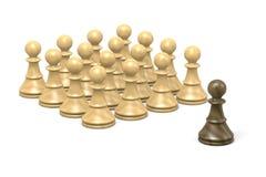 Challenge. Single Black Wood Chessman Against White Chess Pieces on White Background Royalty Free Stock Photo