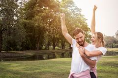 Challenge success couple raising hands for fitness goal achievement. stock photography