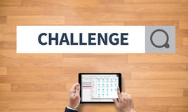CHALLENGE. On the tablet pc screen held by businessman hands - online, top view Stock Photo