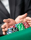 Challenge to the casino. Poker player going all in pushing his chips forward. Challenge to the casino Stock Image