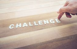 Challenge word with male hand on wood table. Business marketing,analysis concepts Stock Photos