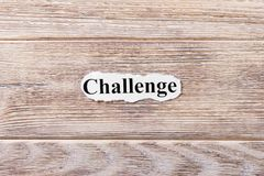 Challenge of the word on paper. concept. Words of Challenge on a wooden background.  Royalty Free Stock Image