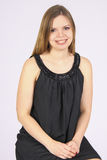 Challenge. Young woman smiling in studio Royalty Free Stock Images
