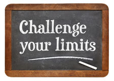 Challenge your limits blackboard sign. Challenge your limits - white chalk text on a vintage slate blackboard Royalty Free Stock Images