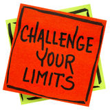 Challenge your limits inspirational reminder note. Challenge your limits inspirational  reminder note - handwriting in black ink on an isolated sticky note Stock Images