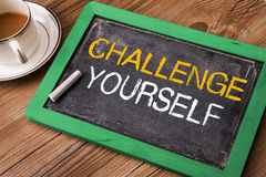 Challenge yourself. Handwritten on blackboard Stock Image