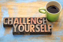 Challenge yourself - word abstract in wood type. Challenge yourself - word abstract in vintage letterpress printing blocks with a cup of coffee Stock Photos