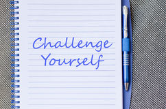 Challenge yourself write on notebook Stock Photos