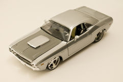 The challenger. Picture of a miniature replica of a toy car Stock Photography