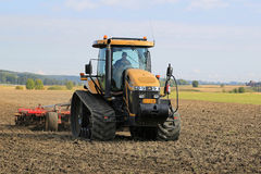 Challenger Agricultural Crawler Tractor on Field in Autumn Stock Photography