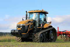Challenger Agricultural Crawler Tractor on Field in Autumn. SALO, FINLAND -SEPTEMBER 6, 2014: Challenger MT765C crawler tractor and cultivator on field. MT765C Stock Photos