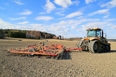 Challenger MT765C Tracked Tractor and Cultivator on Field Stock Photography