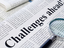 Challenges ahead headline in newspaper Stock Image