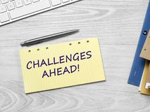 Challenges ahead message. On adhesive note stock photos