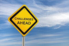 Challenges ahead road sign. Road sign with Challenges ahead text against blue background Royalty Free Stock Photo