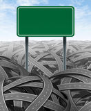 Challenges and obstacles with blank highway sign. Challenges and obstacles with a green blank highway sign representing the concept of solutions and answers in a Royalty Free Stock Photo