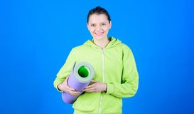 Challenging herself. Health diet. Success. Sporty woman training in gym. Happy woman workout with fitness mat. Strong royalty free stock photo