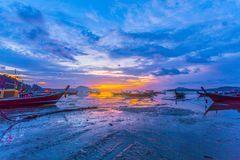 Chalong bay very important for travel business it is a center for all boat and yacht marina. Sweet sunrise above fishing boats in Rawai sea during high tide Royalty Free Stock Photos