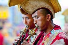 Cham Mystery, Nepal. KATHMANDU, NEPAL - MARCH 25: Buddhist monks playing music during Cham mystery at Shechen monastery on March 25, 2010 in Kathmandu, Nepal Stock Image