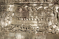 Cham navy in battle, Bayon Temple carving. Ancient Khmer bas relief carving showing Cham fighters taking part in a naval battle on the Tonle Sap lake in Cambodia Stock Photos
