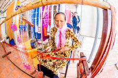 CHAM TEMPLE, PHANRANG, VIETNAM - FEBRUARY 20, 2015 - An ethnic woman weaving decorative scarf Royalty Free Stock Images