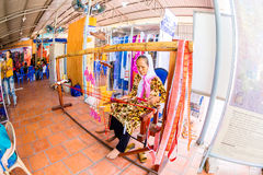 CHAM TEMPLE, PHANRANG, VIETNAM - FEBRUARY 20, 2015 - An ethnic woman weaving decorative scarf with the traditional wooden weaving Stock Photo