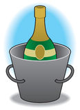 Champagne in bucket. Bottle of champagne chilling in ice bucket Royalty Free Stock Images
