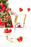 Chamagne, strawberies and christmas tree. Royalty Free Stock Photo