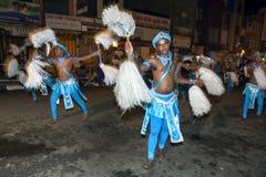 Chamara Dancers perform along the streets of Kandy in Sri Lanka during the Esala Perahera. Chamara Dancers perform along the streets of Kandy in Sri Lanka stock images
