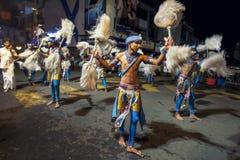 Chamara Dancers perform along the streets of Kandy in Sri Lanka during the Esala Perahera. Chamara Dancers perform along the streets of Kandy in Sri Lanka royalty free stock photo