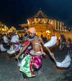 Chamara Dancers perform in front of the Temple of the Sacred Tooth Relic in Kandy in Sri Lanka Kandy during the Esala Perahera. Stock Photo