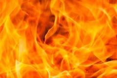 Chamas alaranjadas amarelas do close up do fogo fotografia de stock royalty free