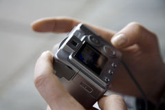 The chamber in hands. The digital camera in hands of the person Stock Image
