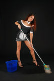Chamber maid in erotic conventionalized suit. Girl in sexual conventionalized suit of chamber maid removes with swab and bucket, spotted short dress, white apron Royalty Free Stock Images
