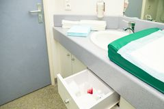 Chamber in the maternity hospital with the necessary things for mother and child stock image