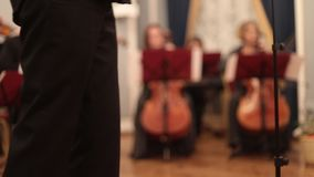 Chamber orchestra. Two women playing cello on the background stock footage